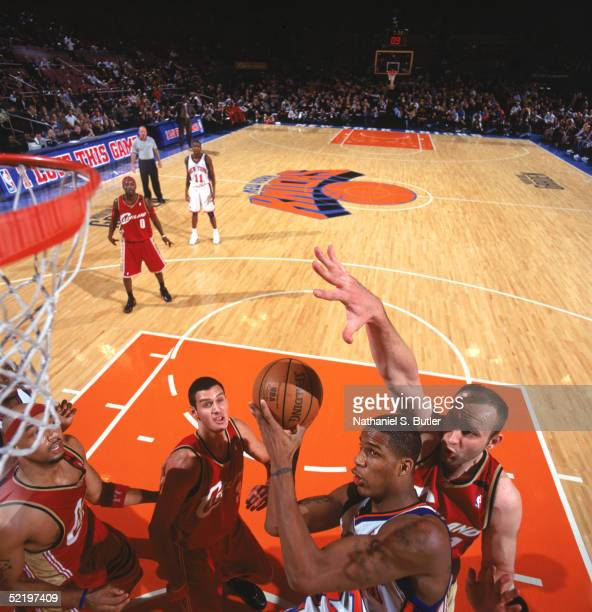 Trevor Ariza of the New York Knicks battles for a shot against Zydrunas Ilgauskas of the Cleveland Cavaliers during a game at Madison Square Garden...