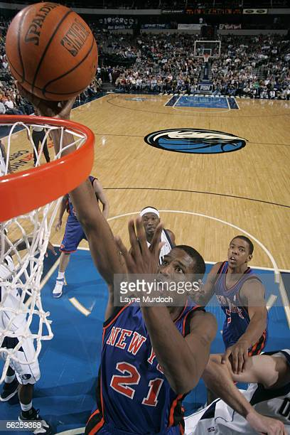 Trevor Ariza of the New York Knicks drives for a shot attempt against the Dallas Mavericks during a preseason game October 21 2005 at the American...