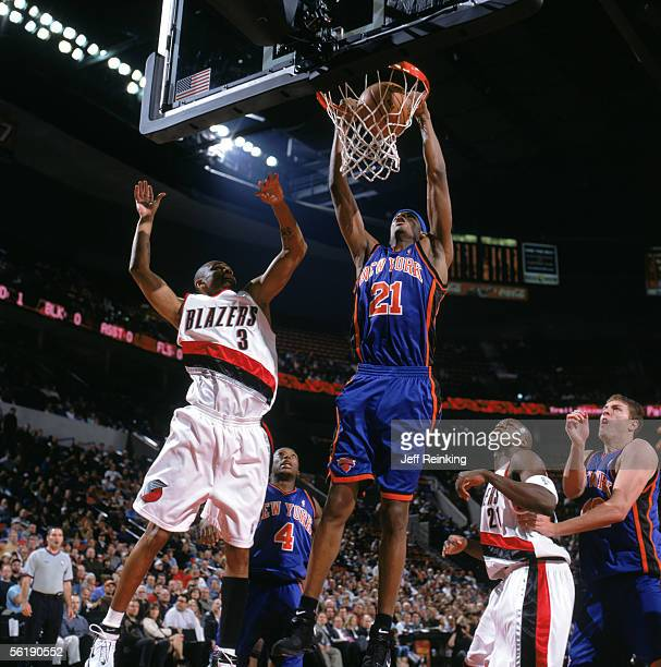 Trevor Ariza of the New York Knicks dunks past Juan Dixon of the Portland Trail Blazers during a game at The Rose Garden on November 9 2005 in...