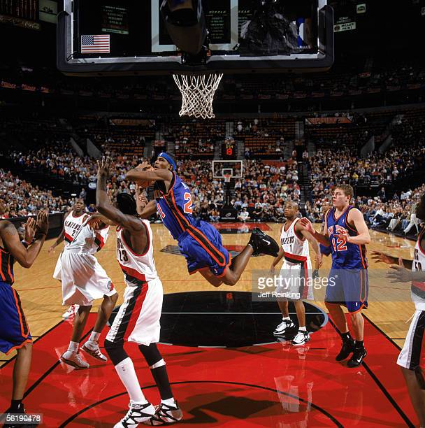 Trevor Ariza of the New York Knicks goes to the basket against Darius Miles of the Portland Trail Blazers during a game at The Rose Garden on...