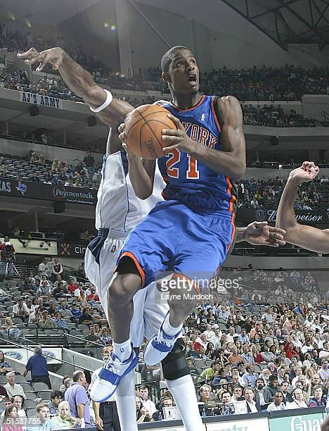 Trevor Ariza of the New York Knicks goes up for a layup against the Dallas Mavericks during NBA action on October 21 2004 at the American Airlines...
