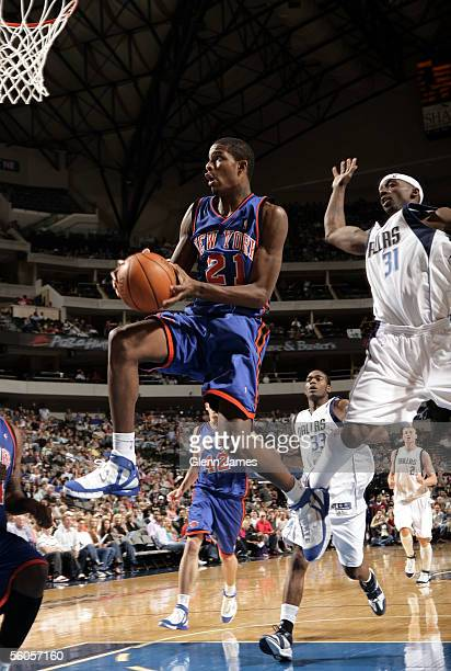 Trevor Ariza of the New York Knicks goes up for a shot in front of Jason Terry of the Dallas Mavericks during the preseason game at American Airlines...