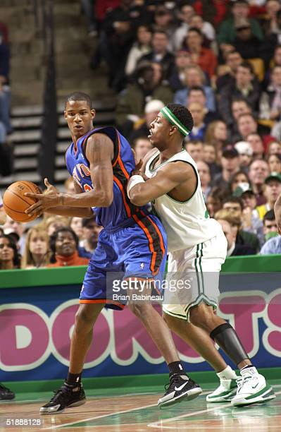 Trevor Ariza of the New York Knicks looks to play the ball against Paul Pierce of the Boston Celtics on December 22 2004 at the Fleet Center in...