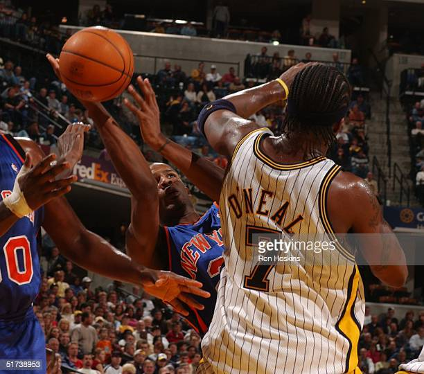 Trevor Ariza of the New York Knicks shoots around Jermaine O'Neal of the Indiana Pacers at Conseco Fieldhouse on November 13 in Indianapolis Indiana...