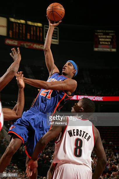 Trevor Ariza of the New York Knicks shoots over Martell Webster of the Portland Trail Blazers on November 9 2005 at the Rose Garden in Portland...