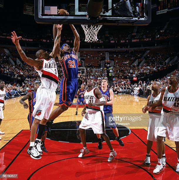 Trevor Ariza of the New York Knicks takes the ball to the basket against Juan Dixon of the Portland Trail Blazers during a game at The Rose Garden on...