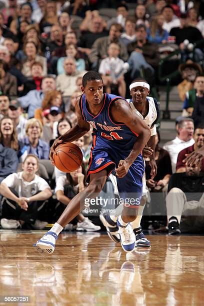 Trevor Ariza of the New York Knicks with the ball as Jason Terry of the Dallas Mavericks is behind him during the preseason game at American Airlines...