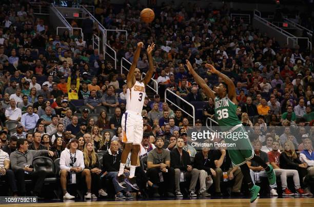 Trevor Ariza of the Phoenix Suns attempts a three point shot agianst Marcus Smart of the Boston Celtics during the NBA game at Talking Stick Resort...