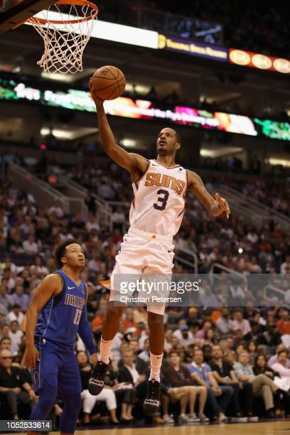 Trevor Ariza of the Phoenix Suns attemtps a shot during the NBA game against the Dallas Mavericks at Talking Stick Resort Arena on October 17 2018 in...