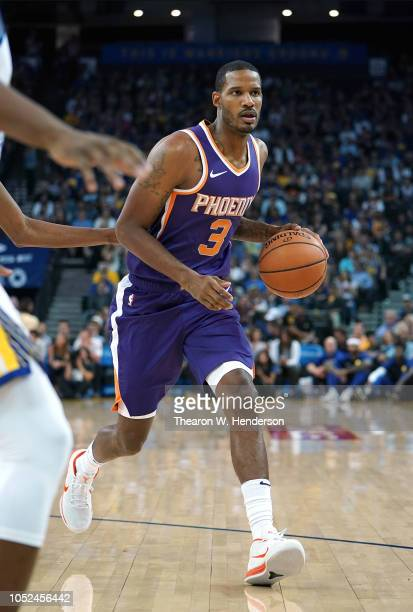 Trevor Ariza of the Phoenix Suns dribbles the ball against the Golden State Warriors during an NBA basketball game at ORACLE Arena on October 8 2018...