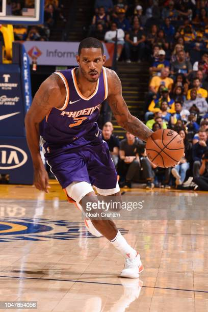 Trevor Ariza of the Phoenix Suns handles the ball against the Golden State Warriors during a preseason game on October 8 2018 at ORACLE Arena in...