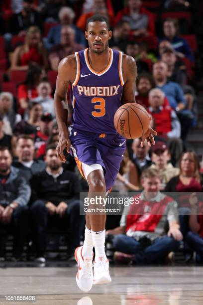 Trevor Ariza of the Phoenix Suns handles the ball against the Portland Trail Blazers during a preseason game on October 10 2018 at Moda Center in...