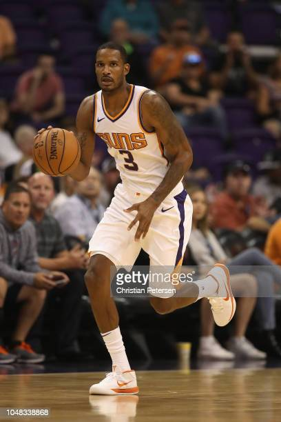 Trevor Ariza of the Phoenix Suns handles the ball during the first half of the NBA preseason game against the Portland Trail Blazers at Talking Stick...