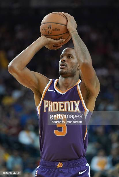 Trevor Ariza of the Phoenix Suns shoots a technical foul shot against the Golden State Warriors during an NBA basketball game at ORACLE Arena on...