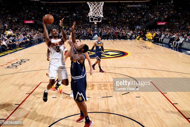 Trevor Ariza of the Phoenix Suns shoots the ball against the Denver Nuggets on October 20 2018 at the Pepsi Center in Denver Colorado NOTE TO USER...