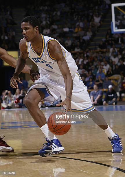 Trevor Ariza of the UCLA Bruins drives to the hoop during the game against the USC Trojans on January 28 2004 at Pauley Pavillion in Westwood...