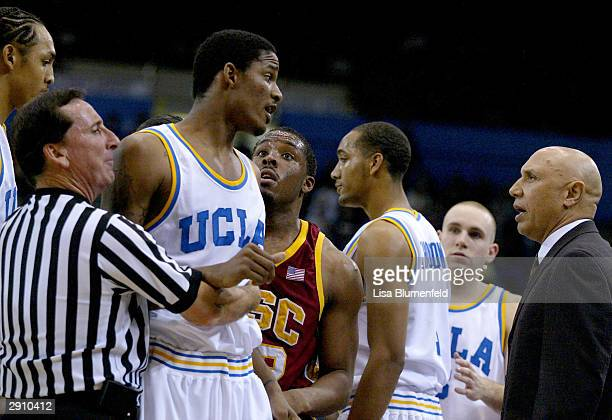 Trevor Ariza of the UCLA Bruins exchanges words with Head Coach Henry Bibby of the USC Trojans January 28 2004 at Pauley Pavilion in Westwood...