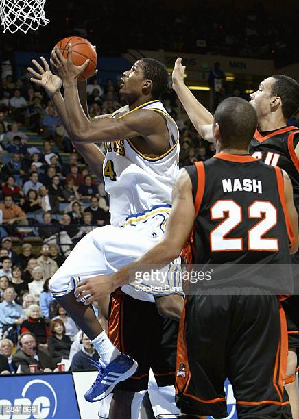 Trevor Ariza of the UCLA Bruins goes up for a shot past J S Nash of the Oregon State Beavers on January 2 2004 at Pauley Pavillion in Westwood...