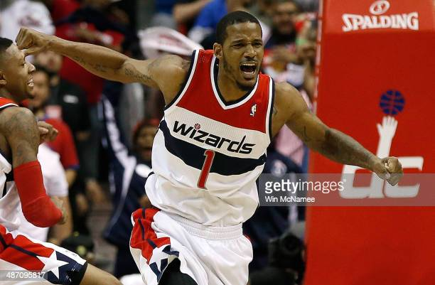 Trevor Ariza of the Washington Wizards celebrates after scoring a key basket late in the fourth quarter against the Chicago Bulls in Game Four of the...