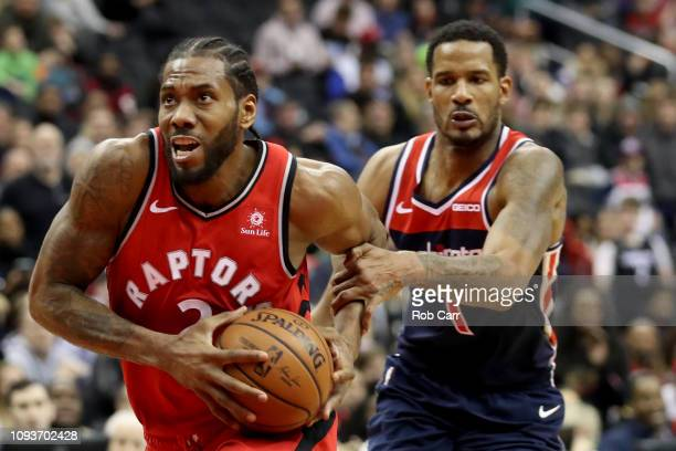 Trevor Ariza of the Washington Wizards fouls Kawhi Leonard of the Toronto Raptors in double overtime at Capital One Arena on January 13 2019 in...