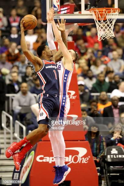 Trevor Ariza of the Washington Wizards goes up against Mike Muscala of the Philadelphia 76ers at Capital One Arena on January 09 2019 in Washington...