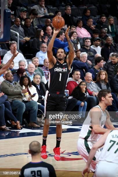 Trevor Ariza of the Washington Wizards shoots a threepointer against the Milwaukee Bucks on January 11 2019 at Capital One Arena in Washington DC...