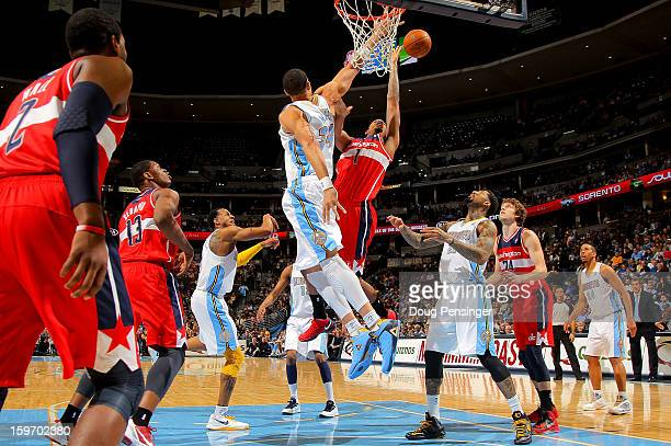 Trevor Ariza of the Washington Wizards takes a shot against JaVale McGee of the Denver Nuggets at the Pepsi Center on January 18 2013 in Denver...