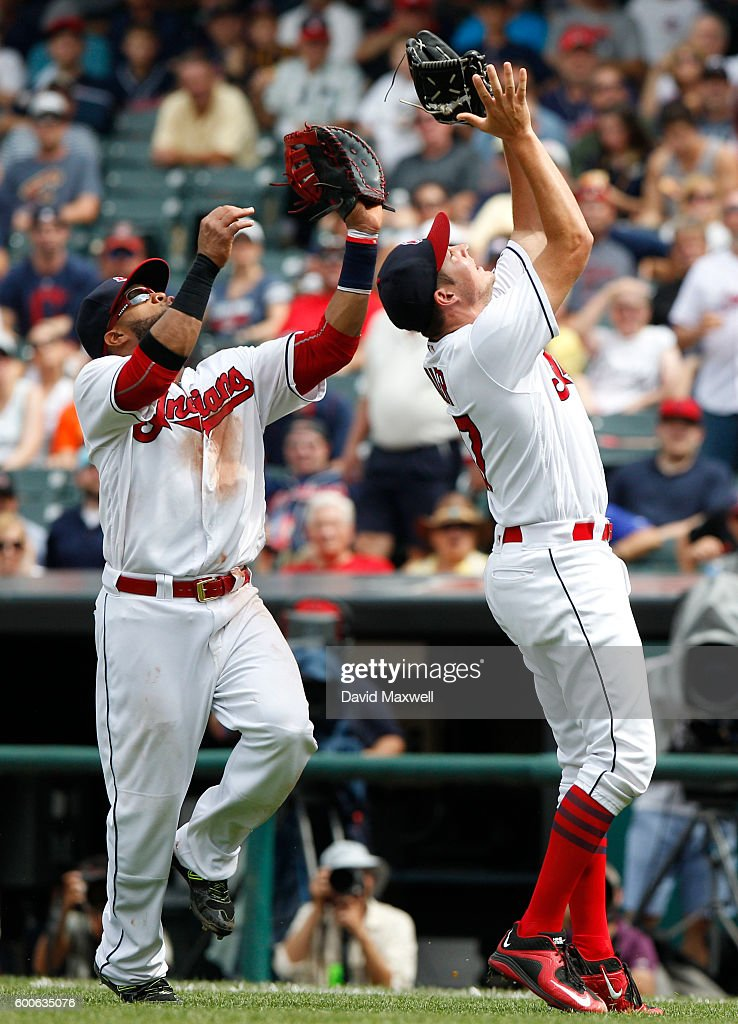 Trevor Bauer #47 and Carlos Santana #41of the Cleveland Indians look to catch pop-up by Jose Altuve (not pictured) of the Houston Astros in the fifth inning at Progressive Field on September 8, 2016 in Cleveland, Ohio.