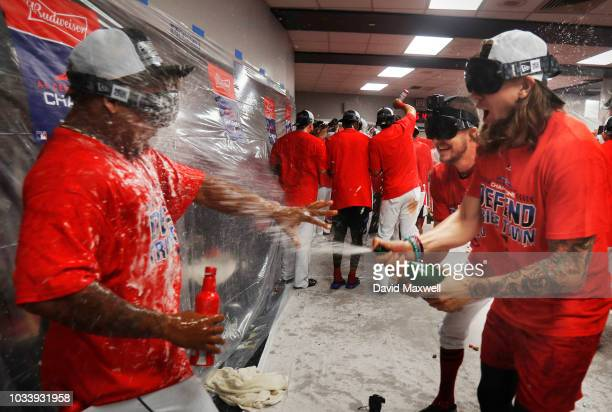 Trevor Bauer and Mike Clevinger of the Cleveland Indians douse teammate Jose Ramirez during a locker room celebration after the Indians defeated the...