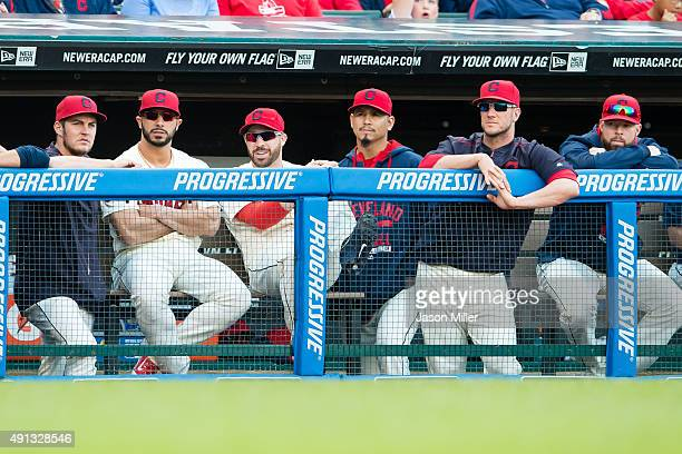 Trevor Bauer Mike Aviles Jason Kipnis Carlos Carrasco Yan Gomes Corey Kluber of the Cleveland Indians watch from the dugout during the eighth inning...