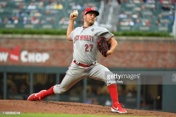Trevor Bauer of the Cincinnati Reds p[itches in the second inning against the Atlanta Braves at SunTrust Park on August 03 2019 in Atlanta Georgia
