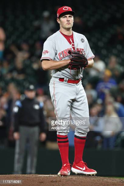 Trevor Bauer of the Cincinnati Reds reacts after giving up a solo home run to Kyle Lewis of the Seattle Mariners in the fifth inning to tie the game...