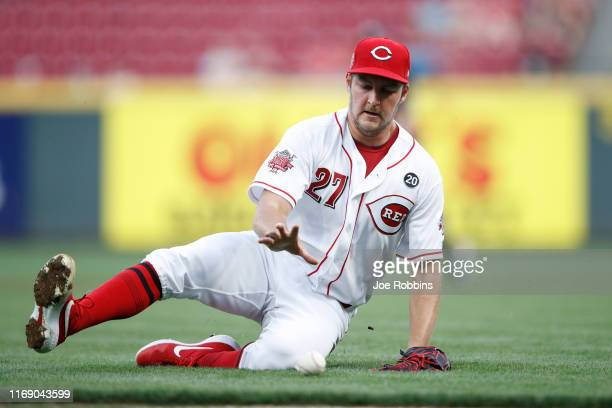 Trevor Bauer of the Cincinnati Reds tries to field the ball near the thirdbase line in the second inning against the San Diego Padres at Great...