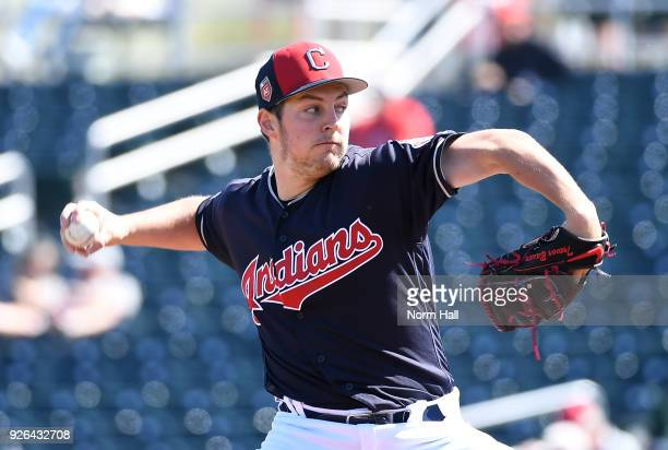 Trevor Bauer of the Cleveland Indians delivers a first inning pitch against the Texas Rangers during a spring training game at Goodyear Ballpark on...