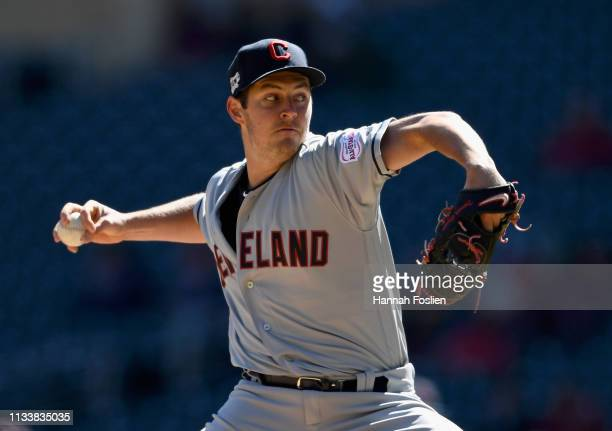 Trevor Bauer of the Cleveland Indians delivers a pitch against the Minnesota Twins during the first inning of the game on March 30 2019 at Target...