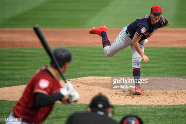 Trevor Bauer of the Cleveland Indians delivers a pitch to Kelby Tomlinson of the Arizona Diamondbacks during the spring training game at Salt River...
