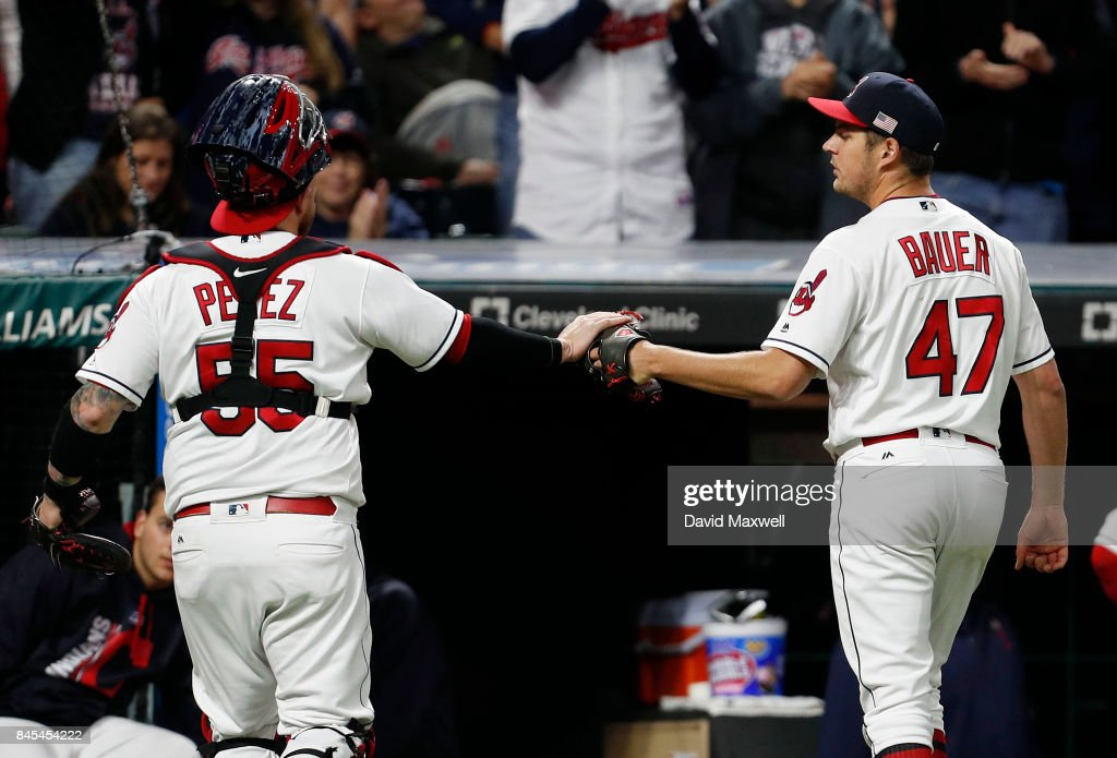 Trevor Bauer #47 of the Cleveland Indians is congratulated by Roberto Perez #55 as they head to the dugout in the fifth inning against the Baltimore Orioles at Progressive Field on September 10, 2017 in Cleveland, Ohio. The Indians defeated the Orioles 3-2, and their win streak now stands at 18.