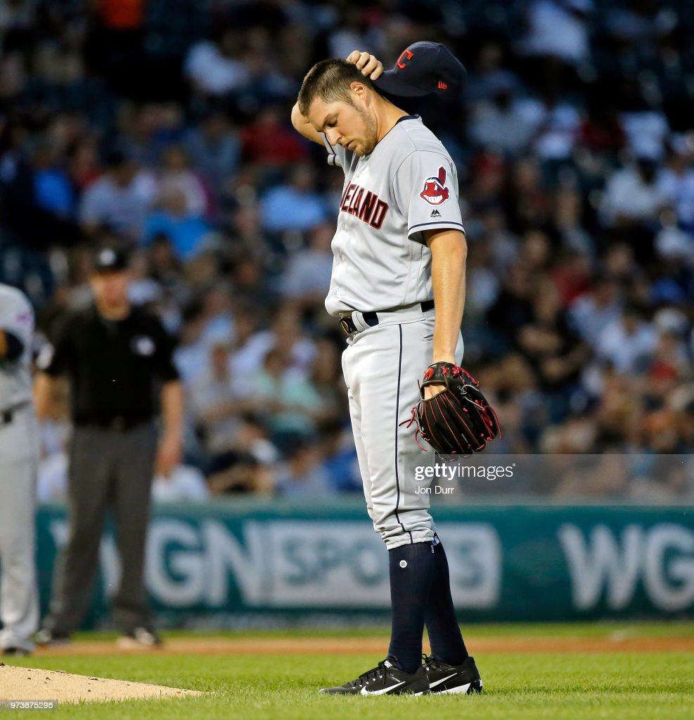 Trevor Bauer #47 of the Cleveland Indians reacts after hitting Tim Anderson #7 of the Chicago White Sox with a pitch during the fifth inning at Guaranteed Rate Field on June 13, 2018 in Chicago, Illinois.