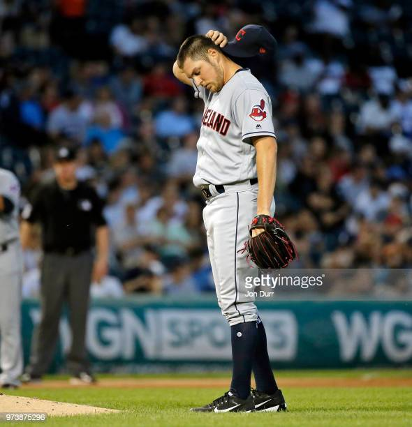 Trevor Bauer of the Cleveland Indians reacts after hitting Tim Anderson of the Chicago White Sox with a pitch during the fifth inning at Guaranteed...