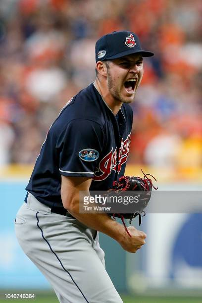 Trevor Bauer of the Cleveland Indians reacts against the Houston Astros at the end of the sixth inning during Game Two of the American League...