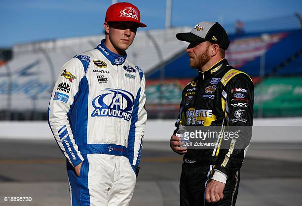Trevor Bayne driver of the AdvoCare Ford talks to Jeffrey Earnhardt driver of the Keen Parts/RainX Ford during qualifying for the NASCAR Sprint Cup...