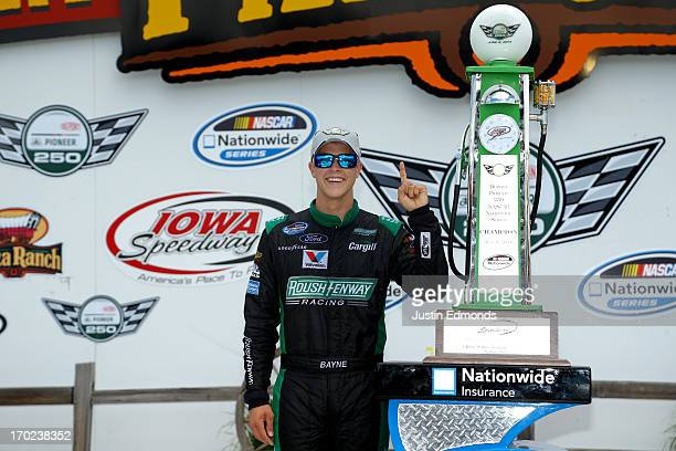 Trevor Bayne, driver of the Ford EcoBoost Ford, celebrates in victory lane after winning the NASCAR Nationwide Series Dupont Pioneer 250 at Iowa...