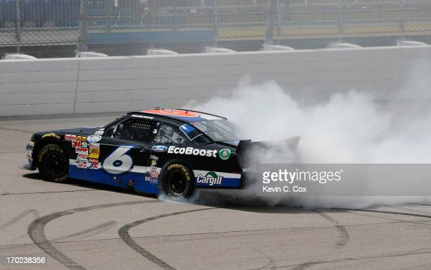 Trevor Bayne driver of the Ford EcoBoost Ford celebrates winning the NASCAR Nationwide Series DuPont Pioneer 250 at Iowa Speedway on June 9 2013 in...