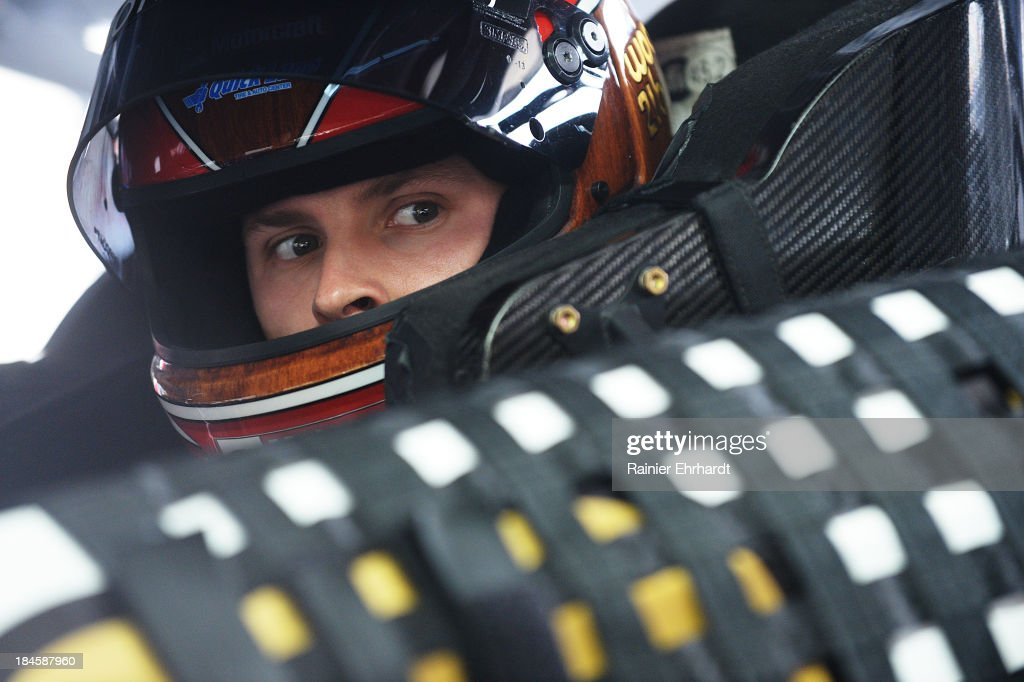 Trevor Bayne, driver of the #21 Wood Brothers Ford, sits in his car during NASCAR Sprint Cup Series testing at Charlotte Motor Speedway on October 14, 2013 in Concord, North Carolina.