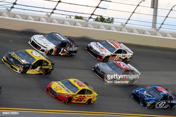 Trevor Bayne leads Jamie McMurray Joey Logano Denny Hamlin Erik Jones and Bubba Wallace through turn 3 during the Coke Zero 400 Monster Energy Cup...