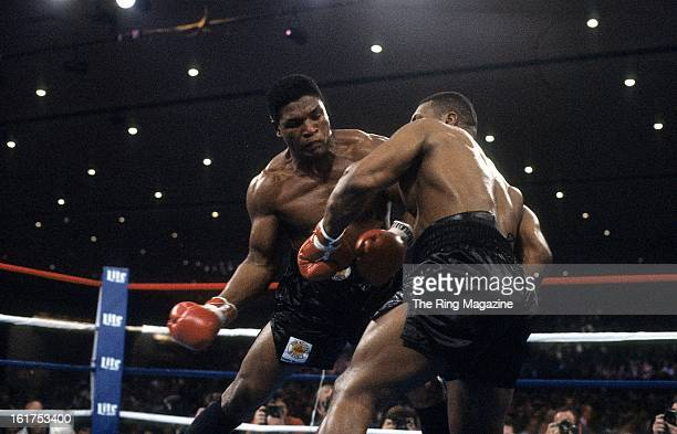 Trevor Berbick throws a punch against Mike Tyson during the fight at Hilton Hotel in Las Vegas Nevada Mike Tyson won the WBC heavyweight title by a...