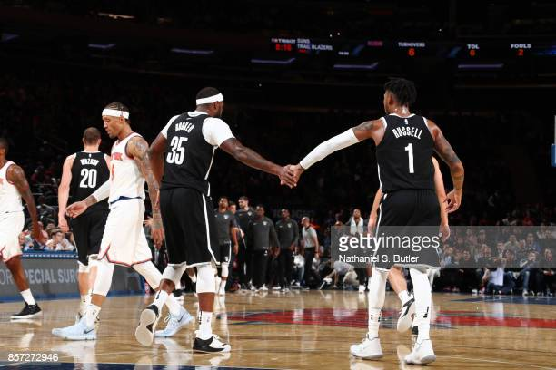 Trevor Booker and D'Angelo Russell of the Brooklyn Nets shake hands during the preseason game against the New York Knicks on October 3 2017 at...