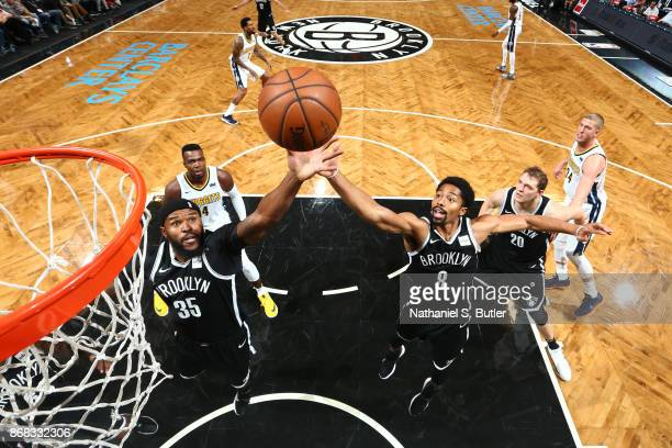 Trevor Booker and Spencer Dinwiddie of the Brooklyn Nets goes up for a rebound against the Denver Nuggets on October 29 2017 at Barclays Center in...