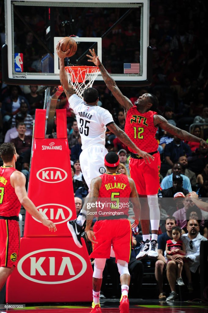 Trevor Booker #35 of the Brooklyn Nets dunks against the Atlanta Hawks on March 26, 2017 at Philips Arena in Atlanta, Georgia.