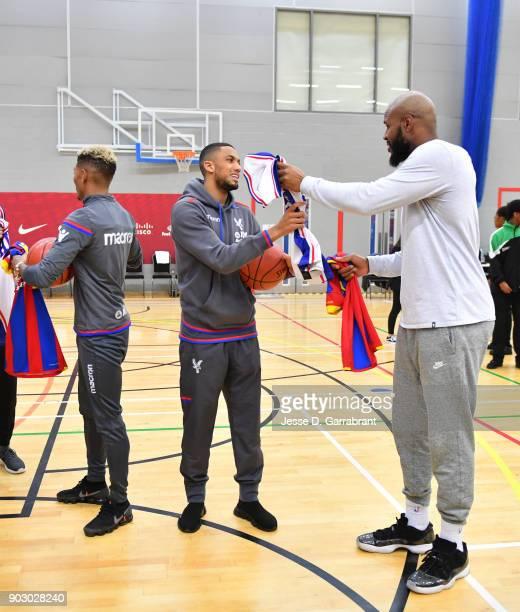 Trevor Booker of the Philadelphia 76ers high fives Ruben LoftusCheek of Crystal Palace Football team an NBA Cares Clinic as part of the 2018 NBA...